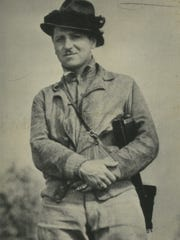 Milwaukee Journal reporter Arville Schaleben poses for a photo while on assignment in Palmer, Alaska, in 1935.
