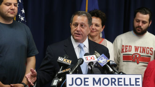 Joe Morelle, surrounded by his family including wife Mary Beth, gives his victory remarks after winning the Democratic primary for Congress Tuesday, June 26, 2018 in Rochester.