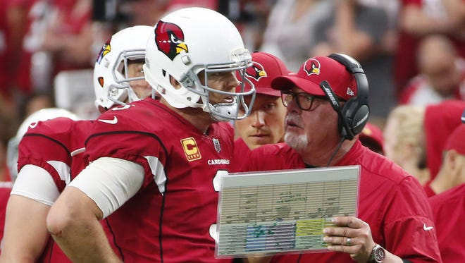 Arizona Cardinals quarterback Carson Palmer (3) talks with Arizona Cardinals head coach Bruce Arians during overtime against the San Francisco 49ers at University of Phoenix Stadium in Glendale, Ariz. October 1, 2017. The Cardinals won 18-15.