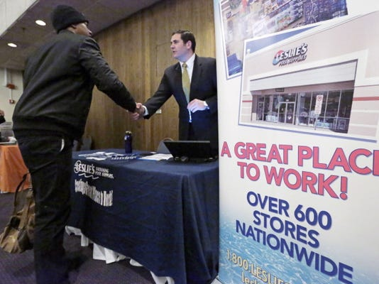 In this April 22, 2015 photo, a sign at a recruiting station for Leslie's Pool supplies boasts that it is a great place to work during a National Career Fairs job fair, in Chicago. The Labor Department releases employment data for April on Friday, May 8, 2015.