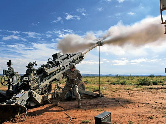 Spc. Derek Grannes, assistant gunner with Battery A, 2nd Battalion, 3rd Field Artillery Regiment, sends a single round down range to verify the M777 howitzer is calibrated on Nov. 4, 2014, at Fort Bliss. Battery A, 2nd Battalion, 3rd Field Artillery Regiment worked closely during Operation Hustler Trough with A-10 pilots from Nellis Air Force Base, Nev.
