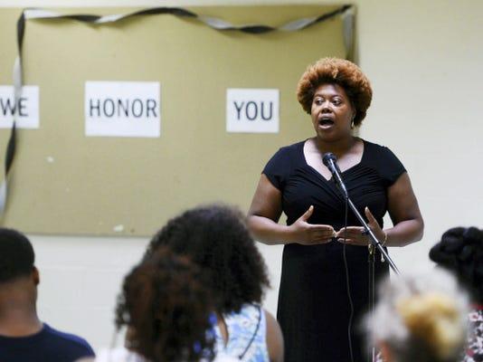 Melissa Robbins of Philadelphia speaks during a vigil for victims of the Charleston shooting at Crispus Attucks in York Tuesday, June 23, 2015.  Kate Penn — Daily Record/Sunday News
