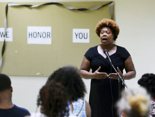 Melissa Robbins of Philadelphia speaks during a vigil for victims of the Charleston shooting at Crispus Attucks in York Tuesday, June 23, 2015.  Kate Penn — Daily Record/Sunday News