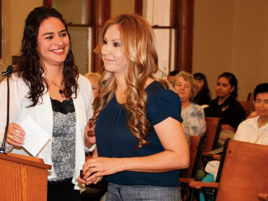 Bill Armendariz - Headlight Photo   Luna county Administrative Assistant Glory Juarez, left, presented Edith Vasquez, the county's DWI Prevention Program grant coordinator, with her five-year service pin during Thursday's Luna County Board of Commissioners Meeting at the historic Luna County Courthouse.