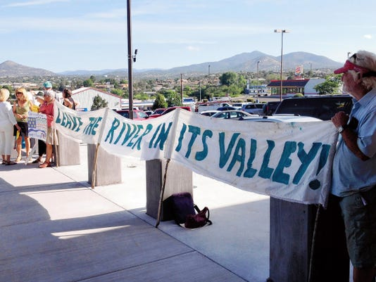 Protesters were in front of the Grant County administration building, encouraging the County Commissioners to vote against the Joint Powers Agreement. However, the commissioners voted 3-0 to approve the JPA. Randal Seyler - Sun-News