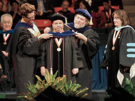 In this file photo, Dr. Leanna Lucero is hooded during commencement ceremonies Saturday at UTEP's Don Haskins Center. Lucero received her Doctorate of Philosophy in Education.