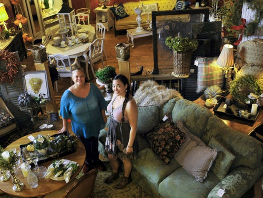 Cari Kreps, left, and Sherry Loving are in the showroom at their new business. Items for sale are on display Friday at Vintage Market at the Old Red Barn on Warm Spring Road, Hamilton Township.