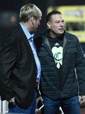 Former Tennessee football coach Butch Jones chats before the Knoxville Catholic-Beech Class 5A state championship game at Tucker Stadium in Cookeville, Tenn., Thursday, Nov. 30, 2017.
