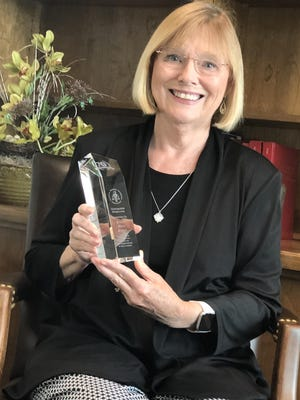 Chief Assistant State Attorney Jeanne Singer with her national award