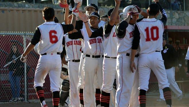 The Cobre High baseball team celebrates after scoring some runs Saturday at Howie Morales Stadium in Bayard.