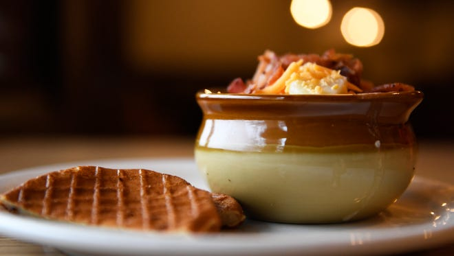 Housemade loaded potato soup with cornbread waffles, is a dish at Cherry Hill Cafe, owned by Mickey Blackman