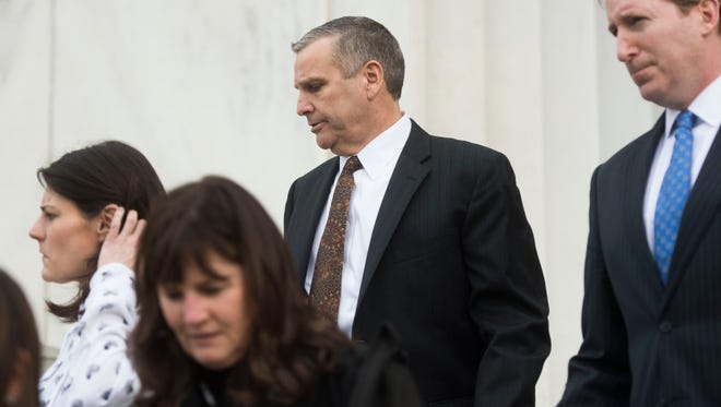 Former Pilot Flying J Vice President Scott Wombold, center, exits the federal courthouse in Chattanooga on Feb. 15, 2018.