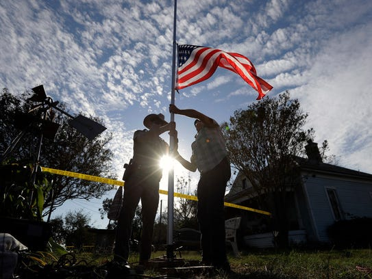 Lowering the flag to half-staff near First Baptist