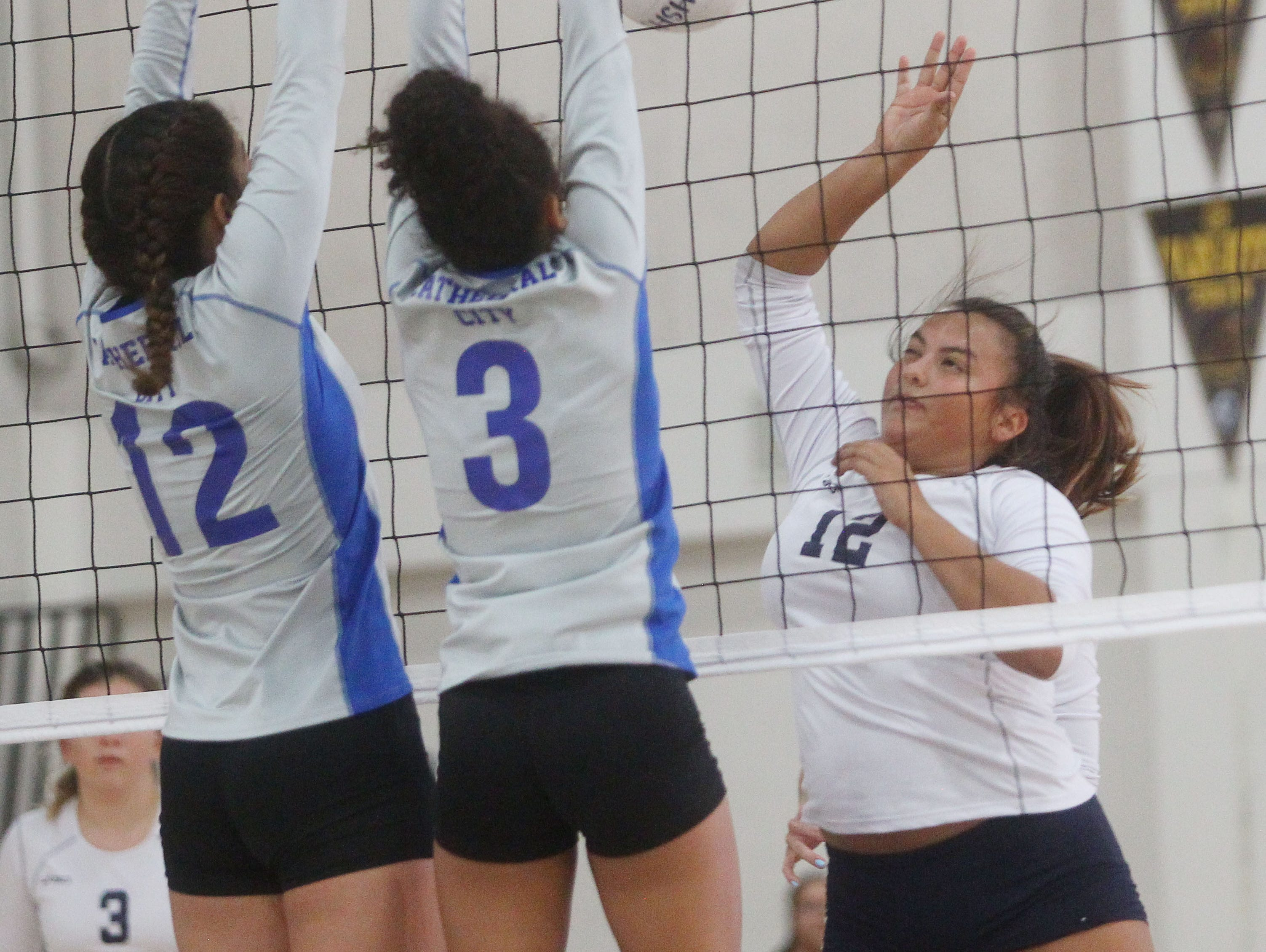 Desert Hot Springs High School girls varsity volleyball team, in white, hosted Cathedral City High School at home. Cathedral City won the game.