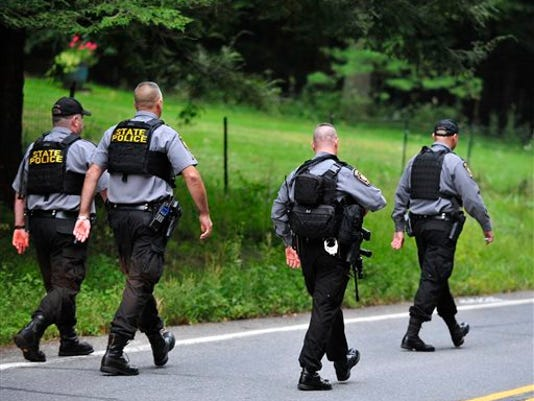 Police surround a neighborhood in the Pocono Mountains while searching for Eric Frein, suspected of killing Cpl. Bryon Dickson outside a state police barracks in northeastern Pennsylvania on Sept. 12., 2014.