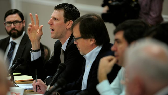 Caleb Hemmer of the Metro Board of Fair Commissioners asks an ATF agent a question about gun sales on Tuesday.