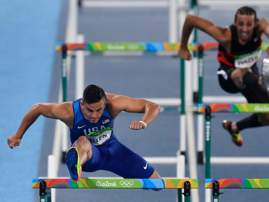United States' Devon Allen, left, competes in a men's 110-meter hurdles heat during the athletics competitions of the 2016 Summer Olympics at the Olympic stadium in Rio de Janeiro, Brazil, Monday, Aug. 15, 2016.