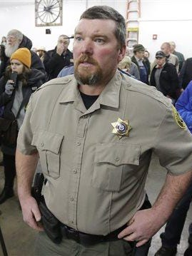 Harney County Sheriff David Ward arrives to a community meeting at the Harney County fairgrounds Wednesday in Burns, Ore. With the takeover entering its fourth day Wednesday, authorities had not removed the group of roughly 20 people from the Malheur National Wildlife Refuge in eastern Oregon's high desert country.