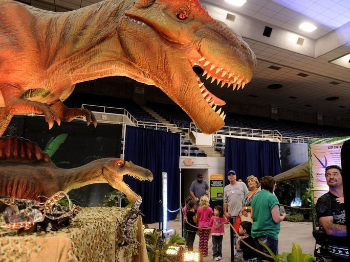 Thomas Metthe/Reporter-News A tyrannosaurus rex greets visitors with a roar during Discover the Dinosaurs Unleashed on Saturday, Oct. 15, 2016, at the Taylor County Coliseum. The event continues 10 a.m. to 5 p.m. Sunday. Admission is $15.