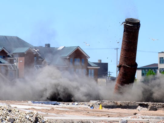 Hamilton Manufacturing Co.'s 233-foot smokestack crumbles