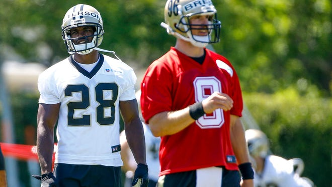New Orleans Saints running back Adrian Peterson (28) stands behind quarterback Drew Brees (9) during practice in Metairie, La., on May 25, 2017.
