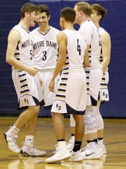Gary Raupers, left, greets Notre Dame's other starters
