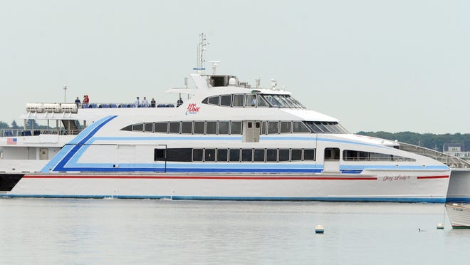 The Grey Lady IV, a high-speed catamaran operated by Hy-Line Cruises, makes its way through Lewis Bay toward Nantucket Sound. The crew aboard the vessel Saturday night rescued a man heard calling for help from the waters of Hyannis Harbor. He had been a passenger on a Steamship Authority ferry.