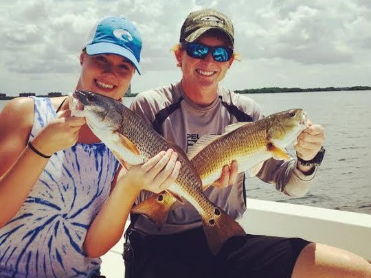 Redfish like this pair of keepers have been coming two at a time for anglers in Estero Bay, with Capt. Matt DeAngelis. That's a sign that summer schooling activity is underway, and quick limits of one red per angler (18 to 27 inches total length) could be easy.