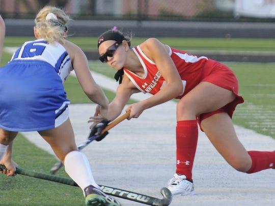 Lauren Schrader attempts a shot against Oley Valley's