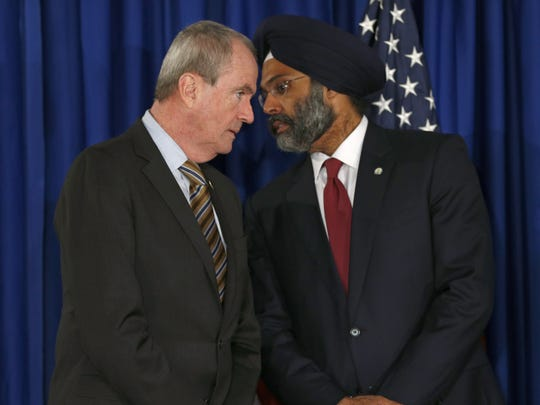 Gov. Phil Murphy, left, speaks with Attorney General Gurbir S. Grewal during a Trenton news conference on Tuesday afternoon, Feb. 20, 2018, where school security was discussed.
