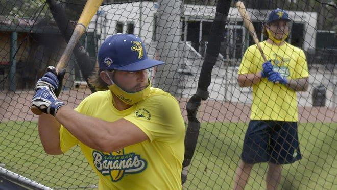 Catcher Bill LeRoy, left, at batting practice Tuesday at Grayson Stadium.