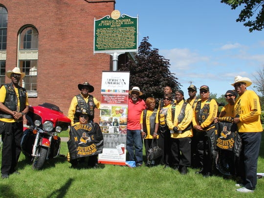 Members of chapters of the Buffalo Soldiers Motorcycle Club from Massachusetts and Connecticut and Curtiss Reed of the Vermont Partnership for Fairness and Diversity pose with a new historic marker honoring the Buffalo Soldiers in Fort Ethan Allen in Colchester on Sunday, July 2, 2017.
