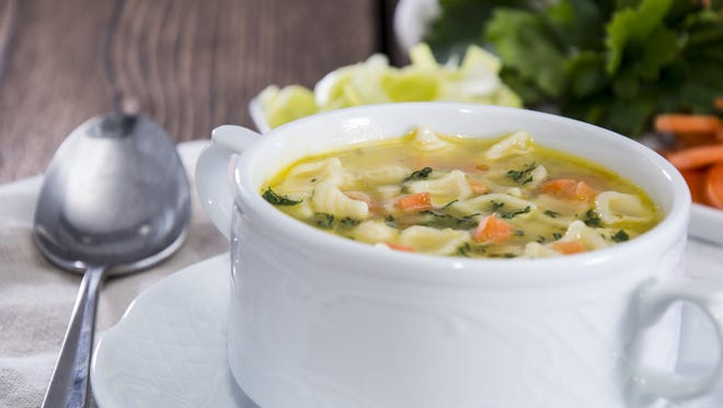 A really great bowl of chicken noodle soup makes it easier to handle, well, almost anything.