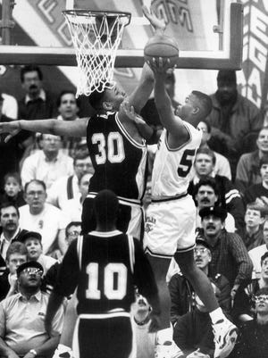 Boylan's Tim Hobson tries to shoot around Chicago King 7-footer Rashard Griffith in 1992.