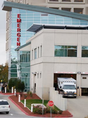 A Dallas County ambulance leaves the emergency room entrance Wednesday, Nov. 2, 2016, at  Mercy Medical Center in Des Moines.
