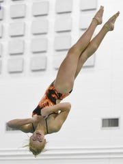 St. Cloud Tech diver Meredith Matchinsky looks for the water as she rotates out of a dive Wednesday during practice.