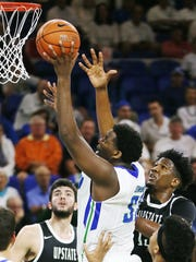 FGCU's Antravious Simmons scores against USC Upstate during play Saturday at Alico Arena in Fort Myers.