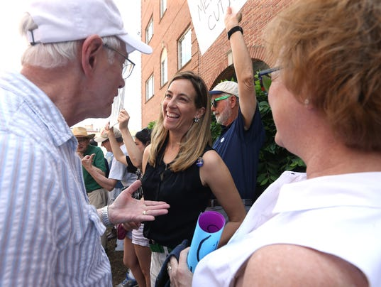 Mikie Sherrill, a former Navy pilot who plans to run in the Democratic primary in the 11th congressional district next year talks with members of the grassroots group NJ 11th for Change at the Morristown office of Congressman Rodney Frelinghuysen