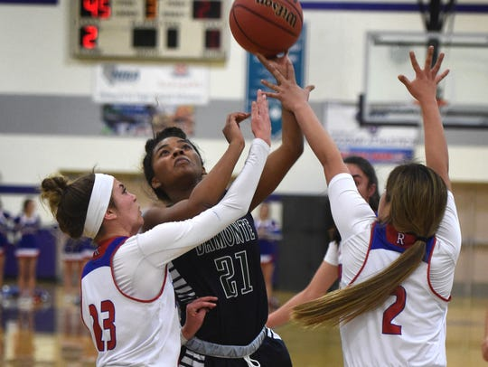Damonte's Alexus Hunter is fouled as she shoots between