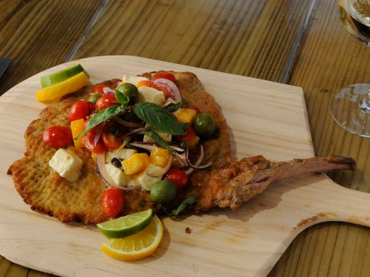 Olivella's Costoletta di Vitello al Bucher is a sauteed veal chop, pounded and breaded, with tomatoes and basil