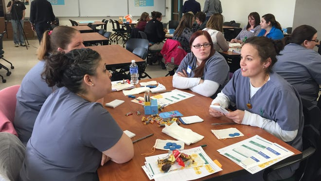 """Ivy Tech Community College nursing students participate in the """"My Gift of Grace"""" game, which stimulates conversation about living and dying. The students include Mariana Aleman, Chelsea Cornell and Tanya Fritts."""