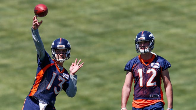 Broncos quarterback Trevor Siemian (13) throws a pass during minicamp at UCHealth Training Center in Englewood, Colo.