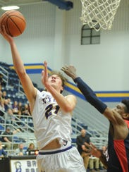 Wylie's Dylan Isenhower, left, shoots over a Life Waxahachie