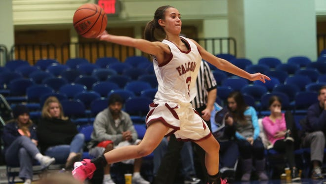 Abertus Magnus' Dani LaRochelle tries to save a ball from going out of bounds against Truman during Saturday's game in the Slam Dunk Tournament at the Westchester County Center in White Plains. Albertus won 61-52.