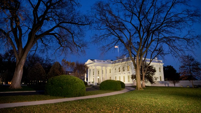 Night falls over the White House at dusk on Nov. 24, 2014.