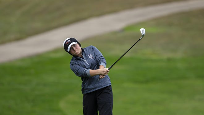 Rochester's Karlie Schnepp chips up to the green on the No. 16 hole during the Auburn Ryder Invite at Edgewood Golf Course, Saturday, October 3, 2020, in Auburn.