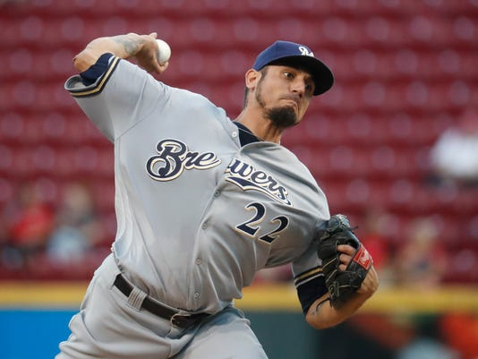 Milwaukee Brewers starting pitcher Matt Garza throws during the first inning of a baseball game against the Cincinnati Reds, Tuesday, Sept. 13, 2016, in Cincinnati. (AP Photo/John Minchillo)