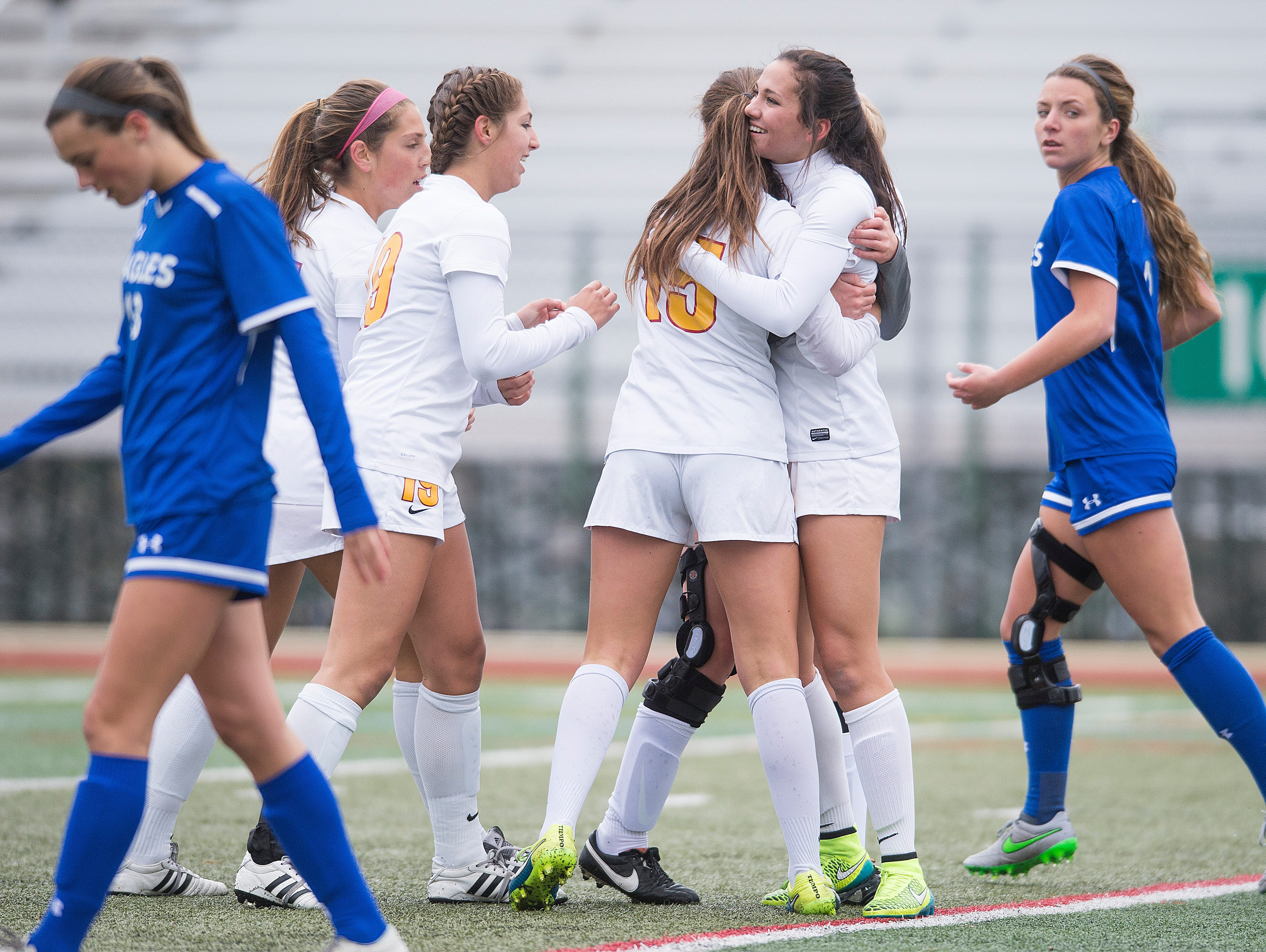 The Rocky Mountain High School soccer team celebrates a goal from Jade Gosar during a game against Broomfield at French Field Thursday, April 28, 2016. The Lobos defeated the Eagles 2-1 in double overtime.