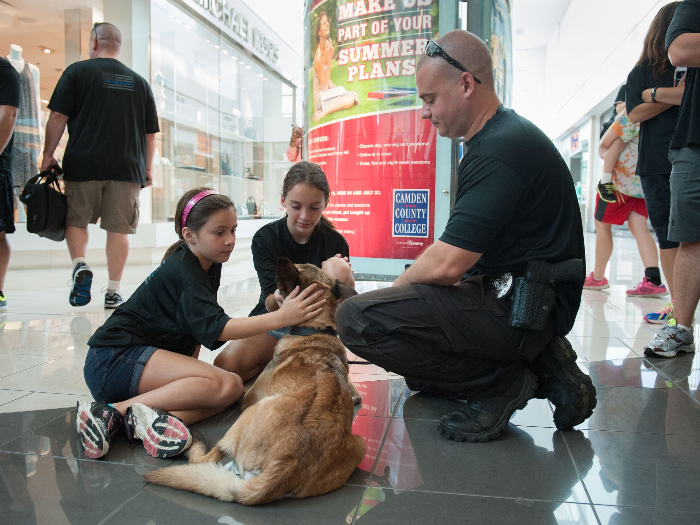 Officer Gary D'Alessio with the Cherry Hill Police Department pet K-9 dog Pandora in 2015 at a community event at the Cherry Hill Mall.