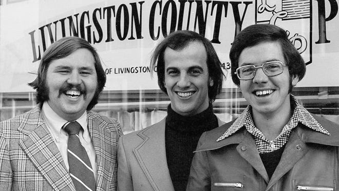 Lee Shelander, left, Rich Perlberg and John Galloway pose for a photo in 1974, soon after their arrival at the then-Livingston County Press. Shelander worked in both news and sports, helping beef up sports coverage in the paper. Perlberg worked for 39 years at the paper before his retirement in 2013 and Galloway now works as a freelance photographer. Their arrival marked a change in emphasis to stronger reporting in the LCP.